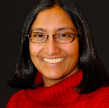 Sadia's headshot. She is in a red sweater.