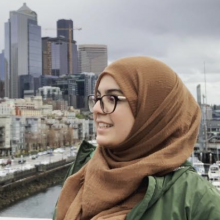 Fatima side profile shot with Seattle backdrop.
